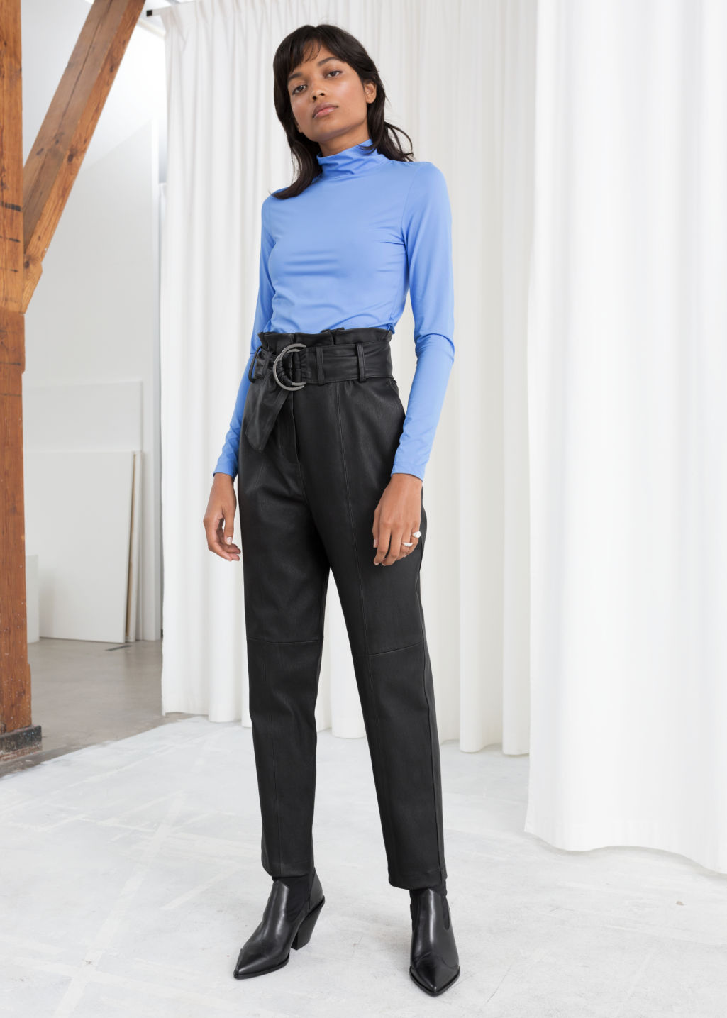 Model front image of Stories paperbag waist leather trousers in black