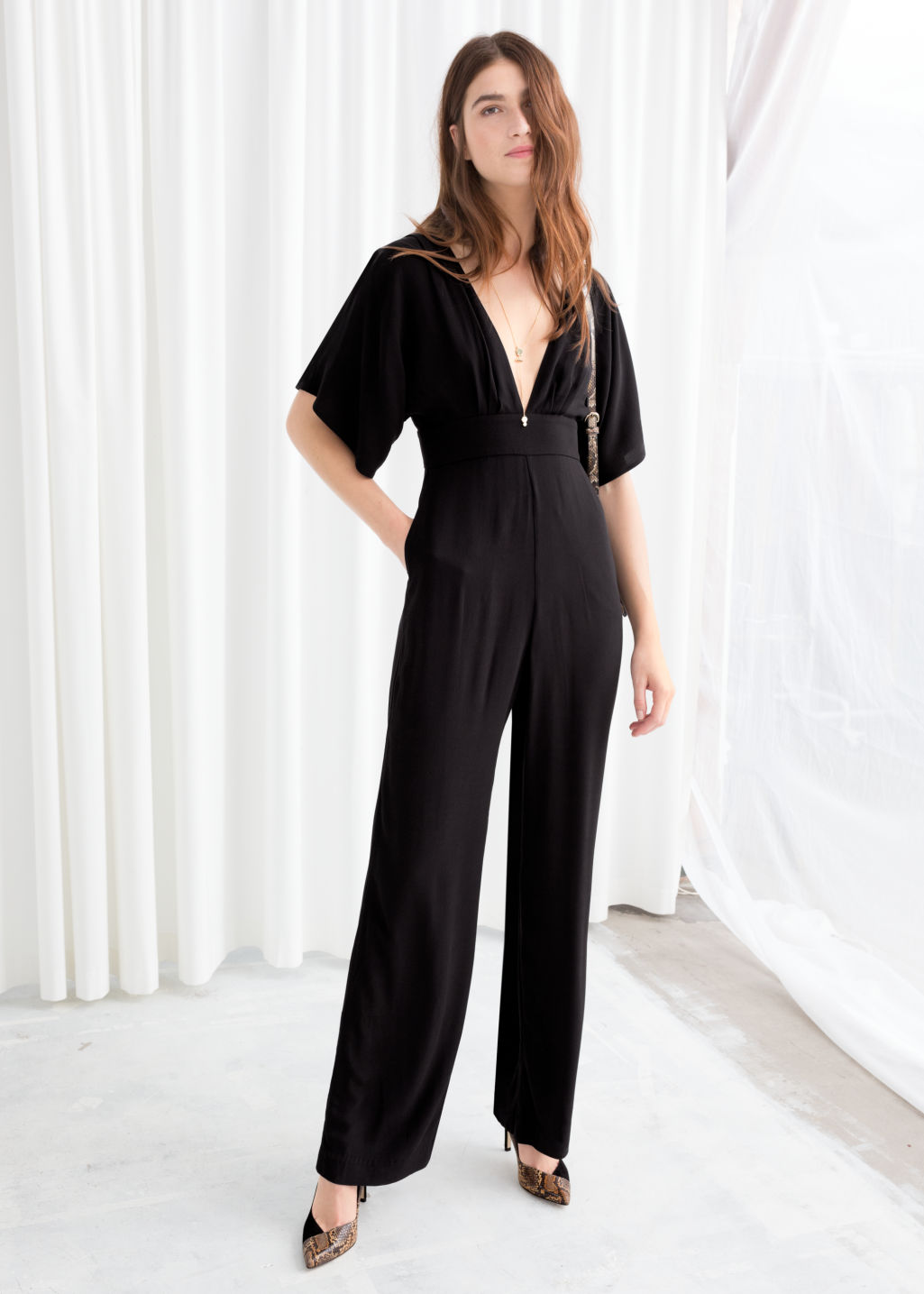 Model front image of Stories plunging v-cut jumpsuit in black