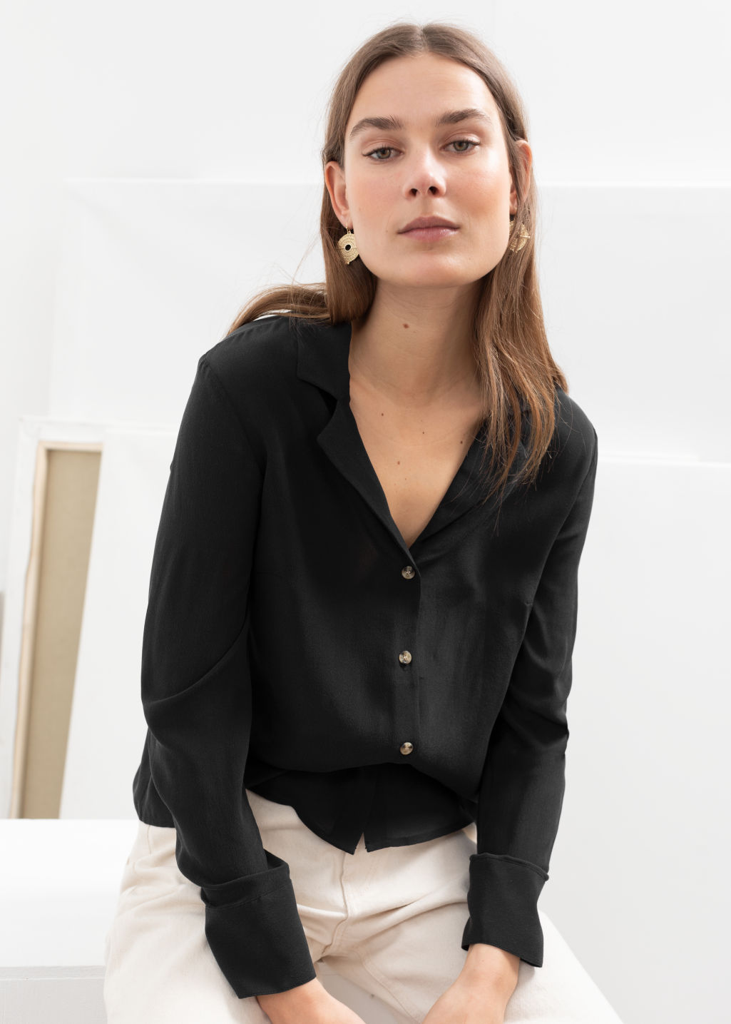 2b1602653 Model front image of Stories v-cut silk button down blouse in black ...