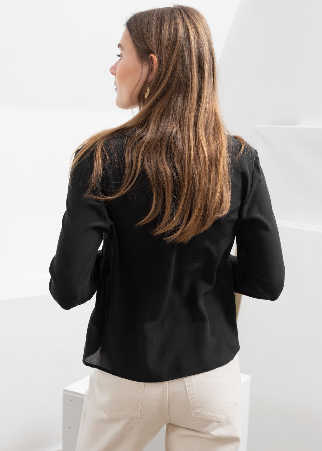 Model back image of Stories v-cut silk button down blouse in black