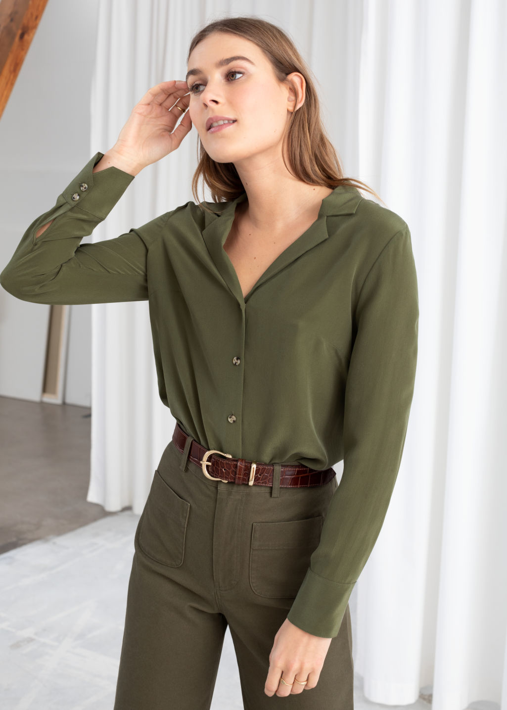 Model front image of Stories v-cut silk button up blouse in green