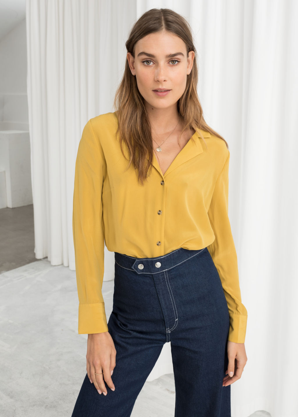 Model front image of Stories v-cut silk button up blouse in yellow