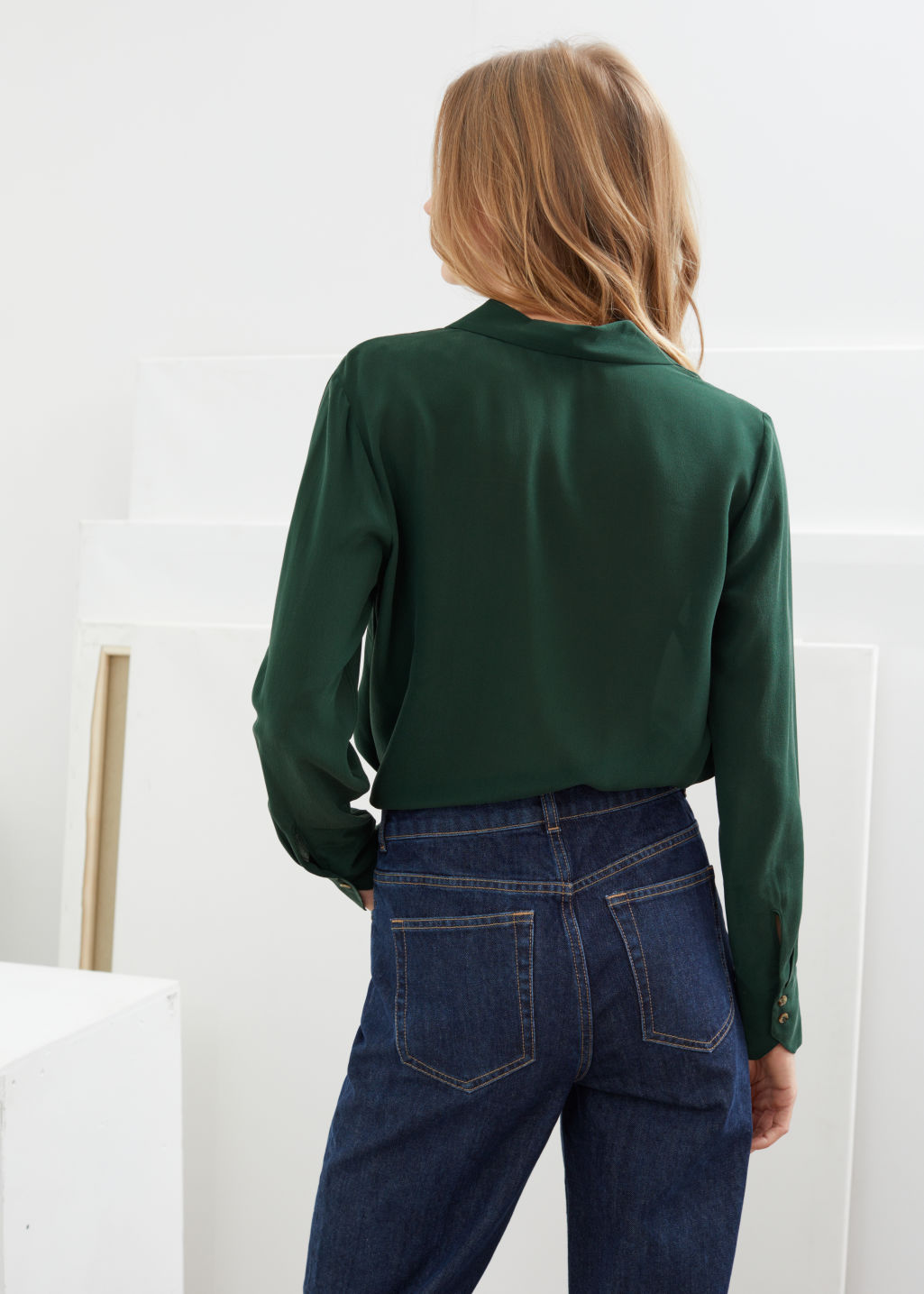 Model back image of Stories v-cut silk button up blouse in green