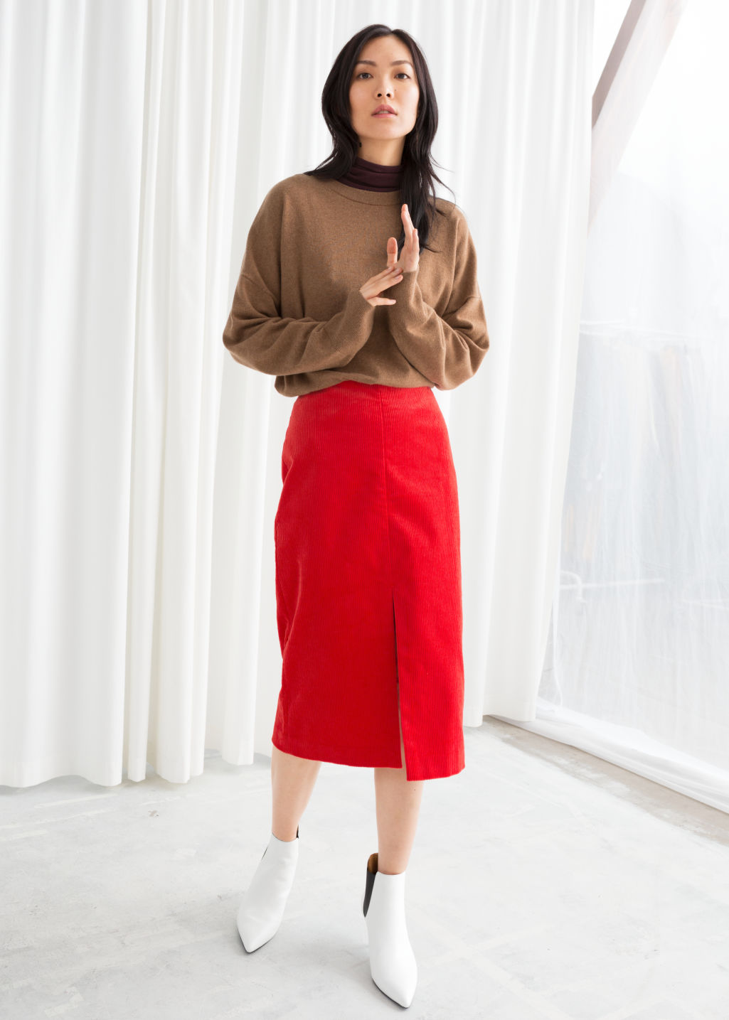 Model front image of Stories front slit corduroy midi skirt in red