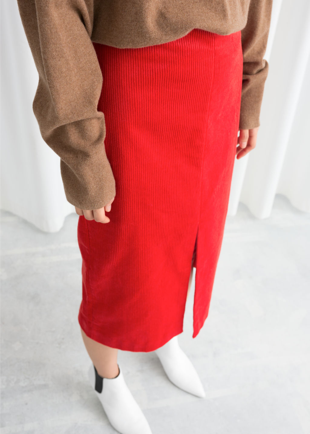 Model back image of Stories front slit corduroy midi skirt in red