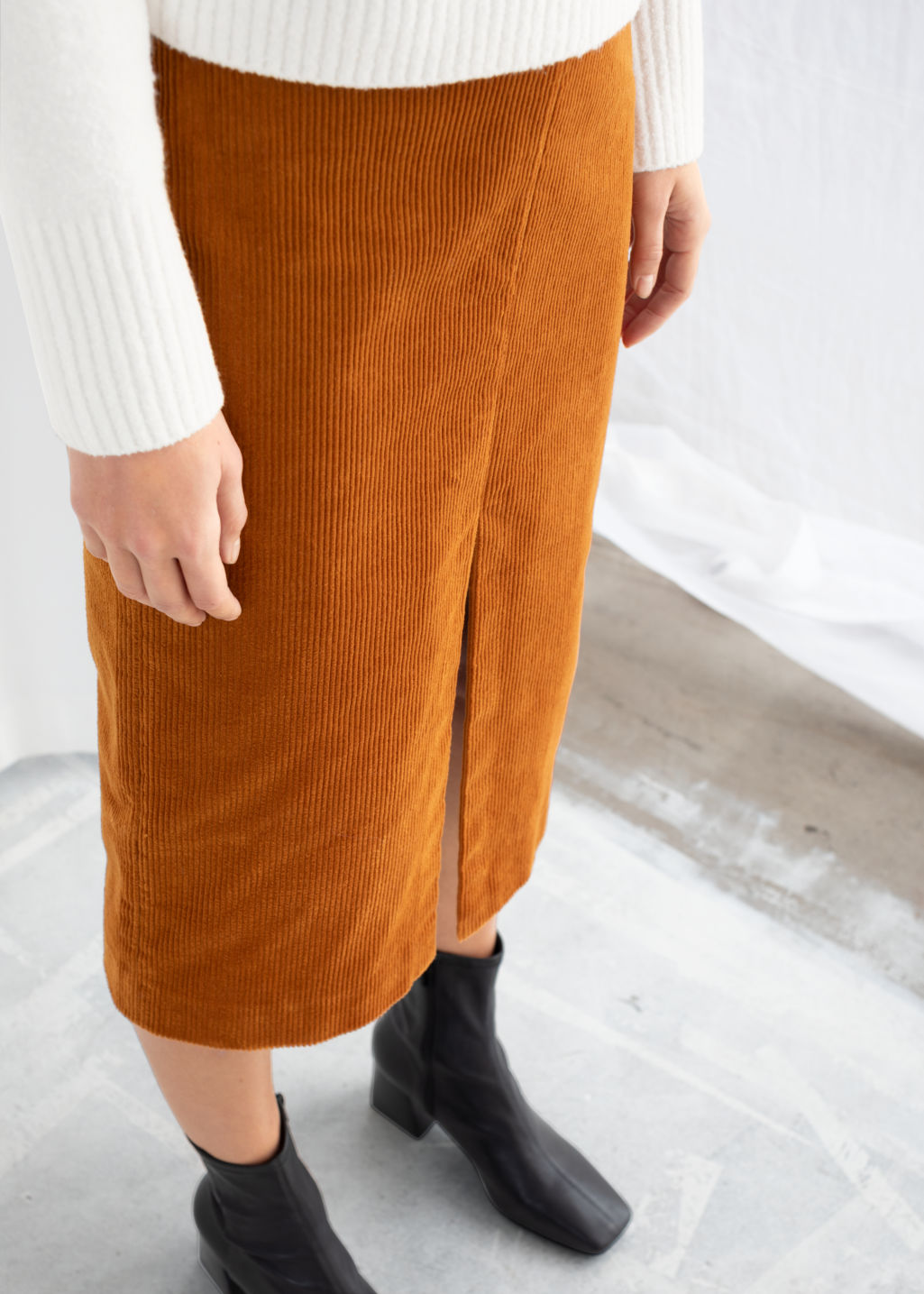 Model front image of Stories front slit corduroy midi skirt in orange