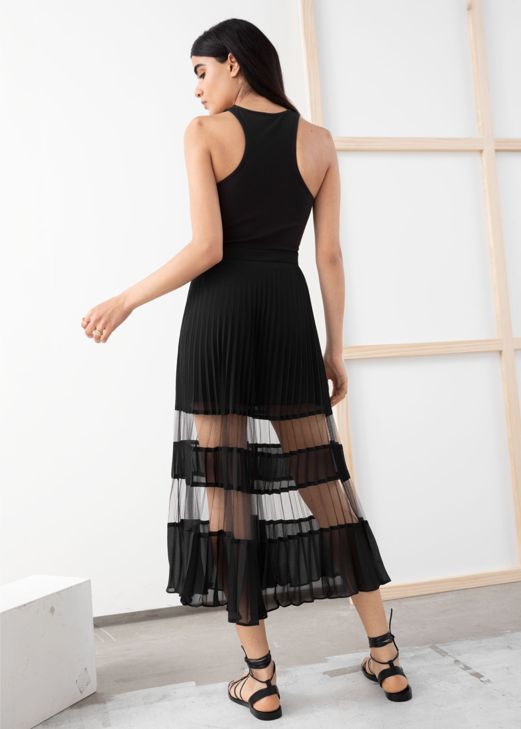 Model back image of Stories pleated mesh stripe midi skirt in black