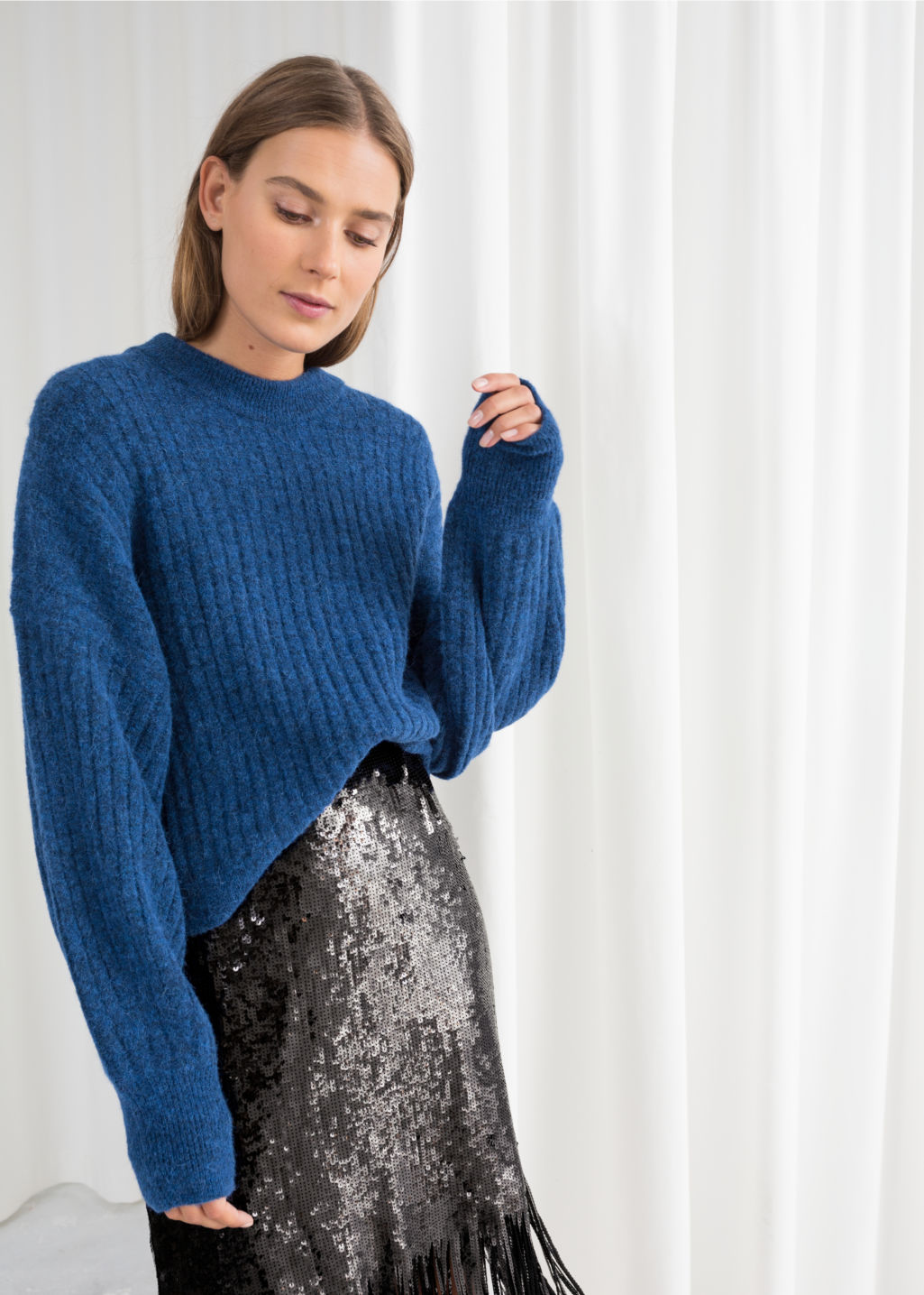 Model front image of Stories alpaca blend knit sweater in blue