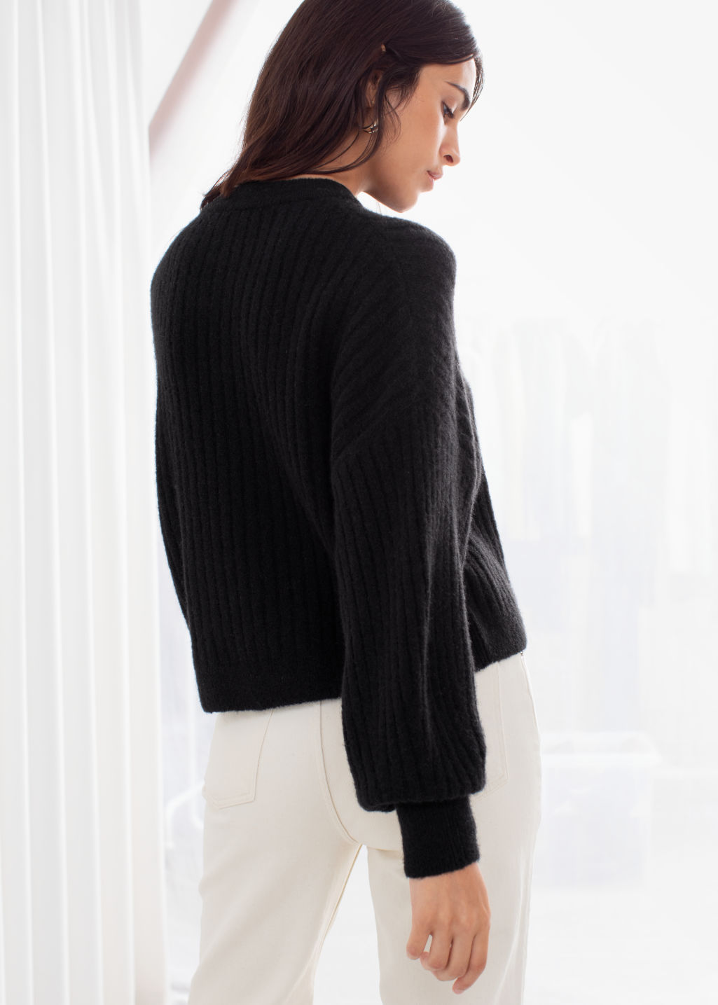 Model back image of Stories alpaca blend knit sweater in black