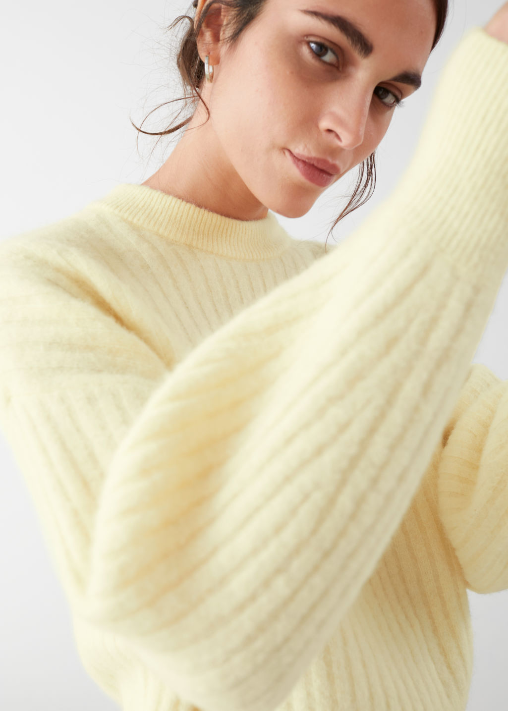Model front image of Stories alpaca blend knit sweater in yellow