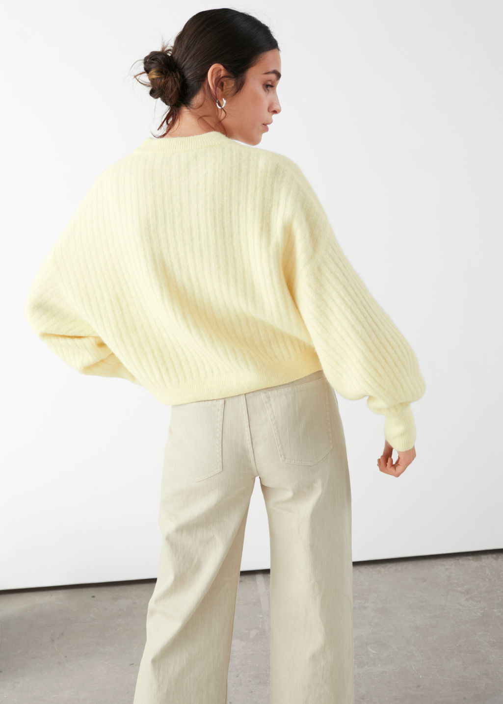 Model back image of Stories alpaca blend knit sweater in yellow