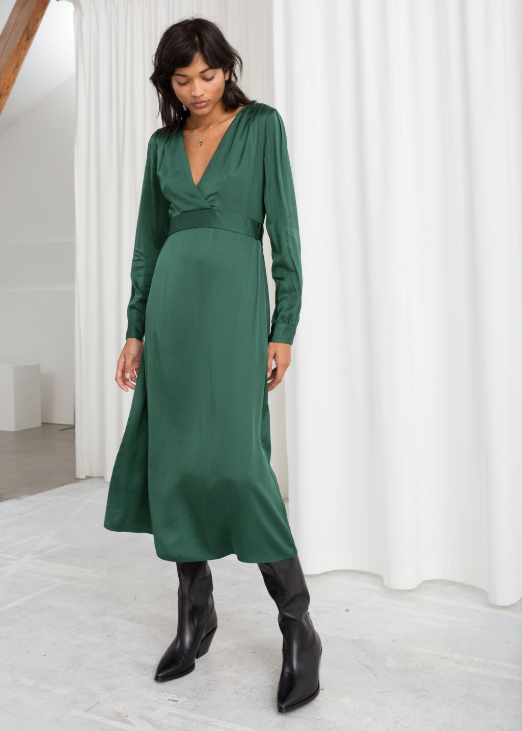 fbb1ad081915 Model front image of Stories plunging ruched midi dress in green ...