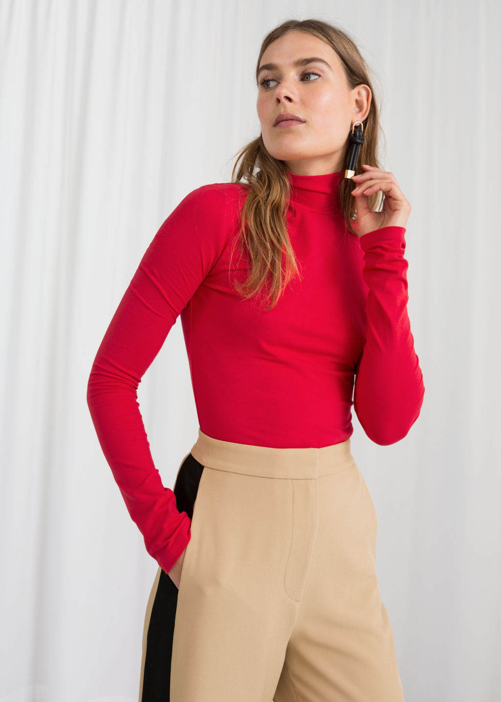 Model front image of Stories stretch cotton turtleneck in red