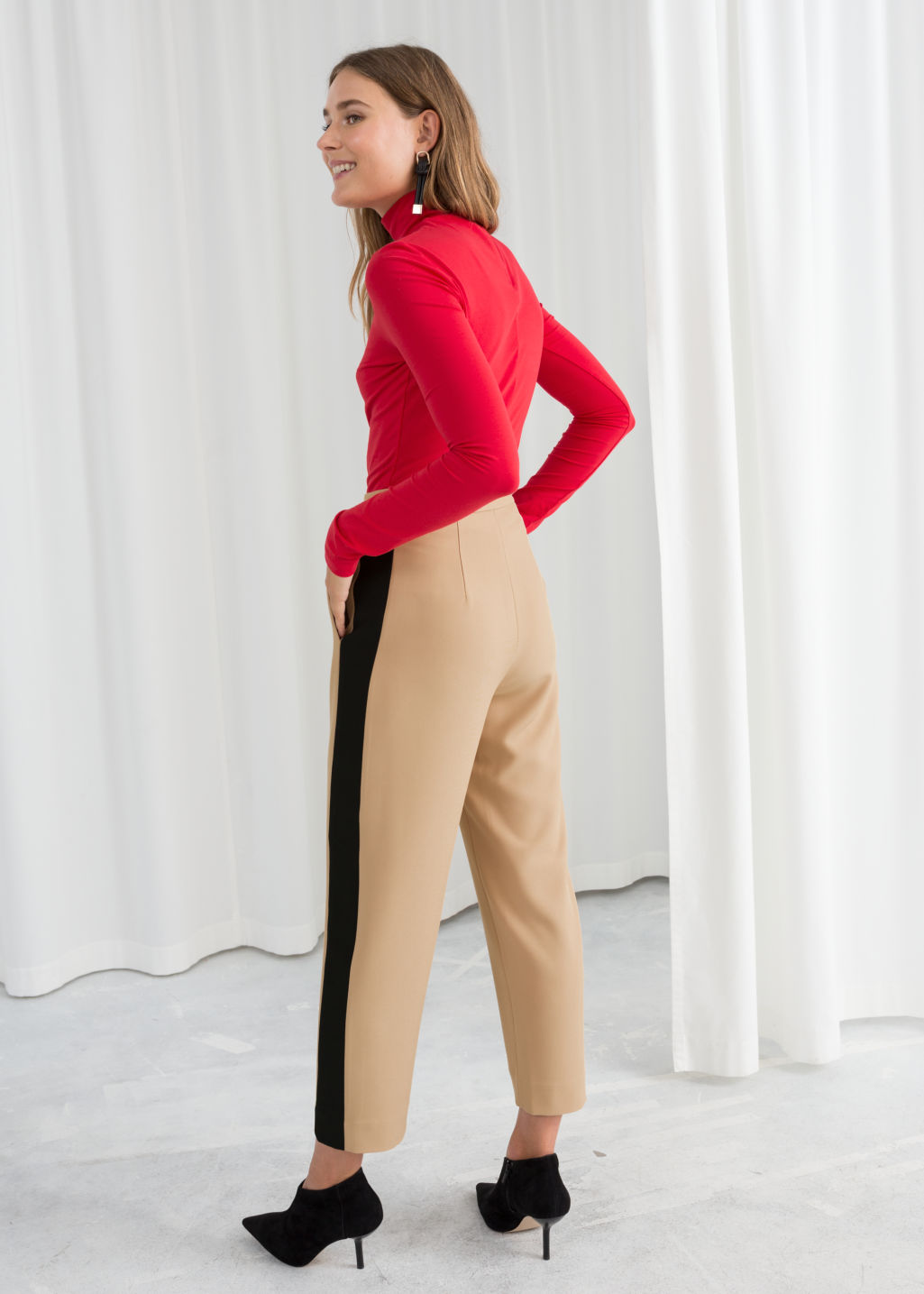 Model back image of Stories stretch cotton turtleneck in red