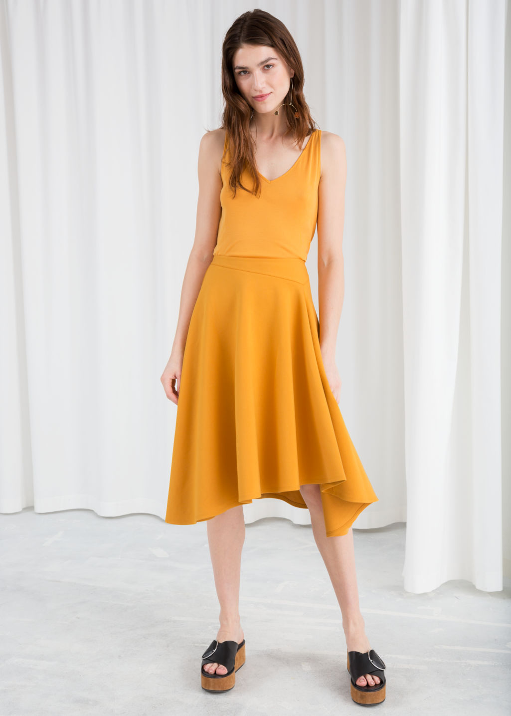 Model front image of Stories voluminous a-line skirt in yellow