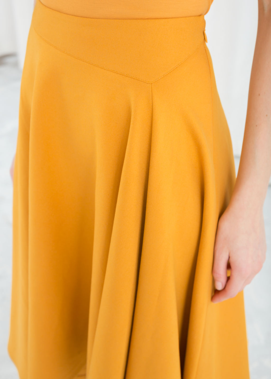 Model back image of Stories voluminous a-line skirt in yellow