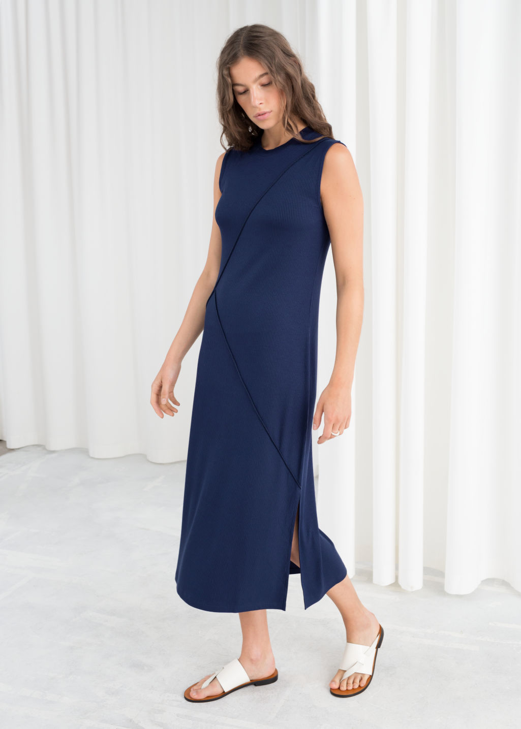 Model front image of Stories angled seam midi dress in blue