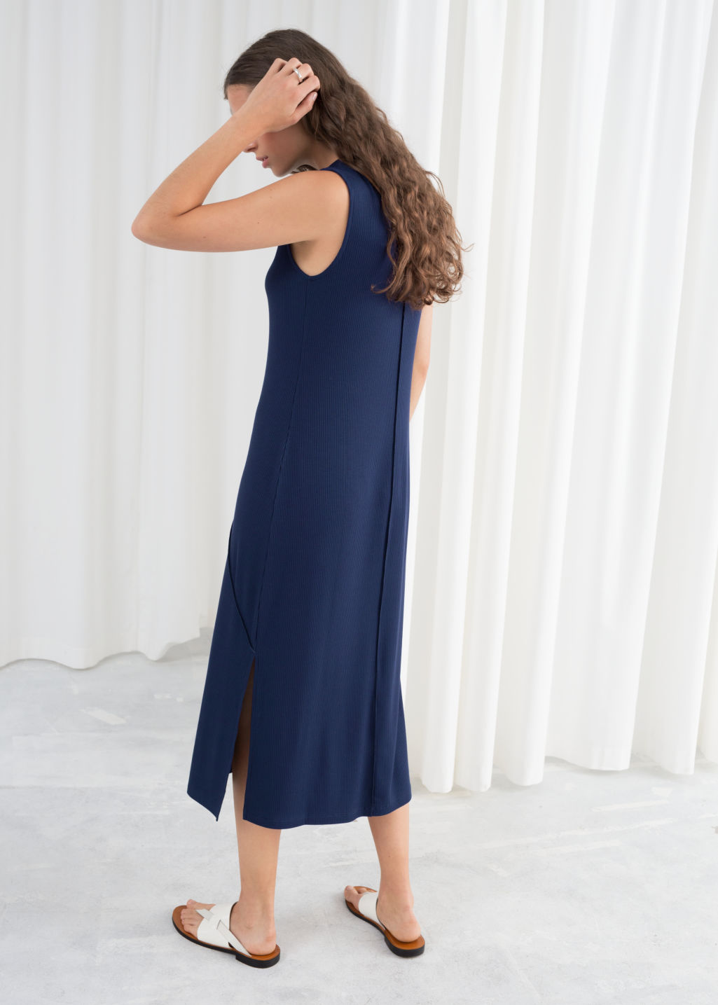 Model back image of Stories angled seam midi dress in blue