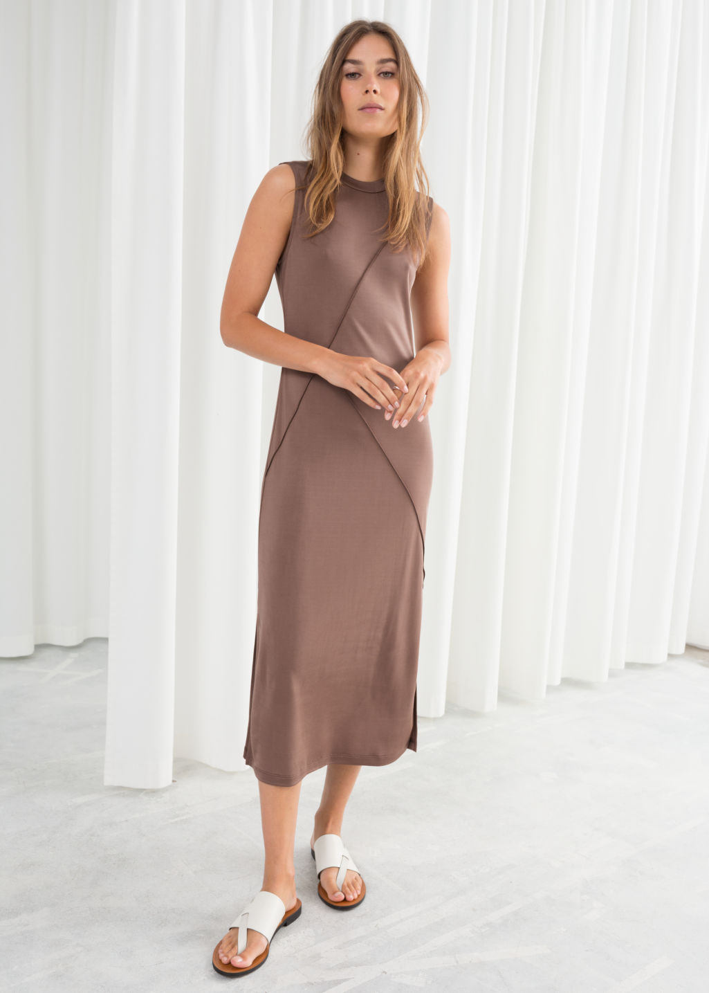 Model front image of Stories angled seam midi dress in beige