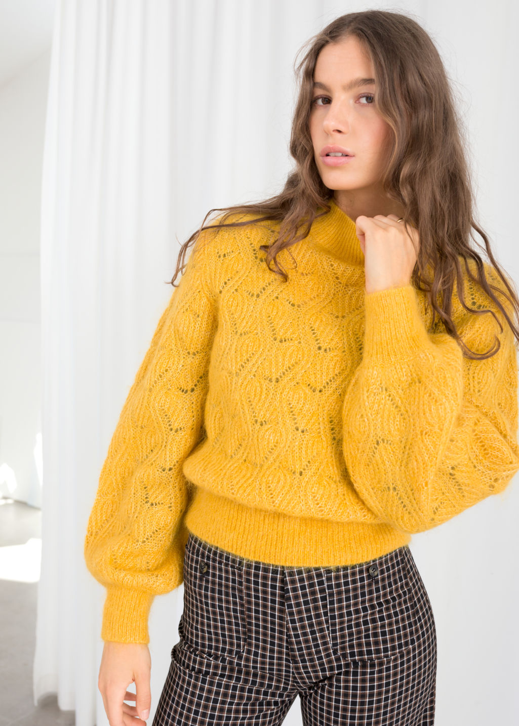 Model front image of Stories eyelet knit wool blend sweater in yellow
