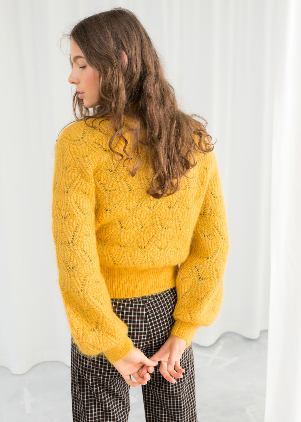 Model back image of Stories eyelet knit wool blend sweater in yellow