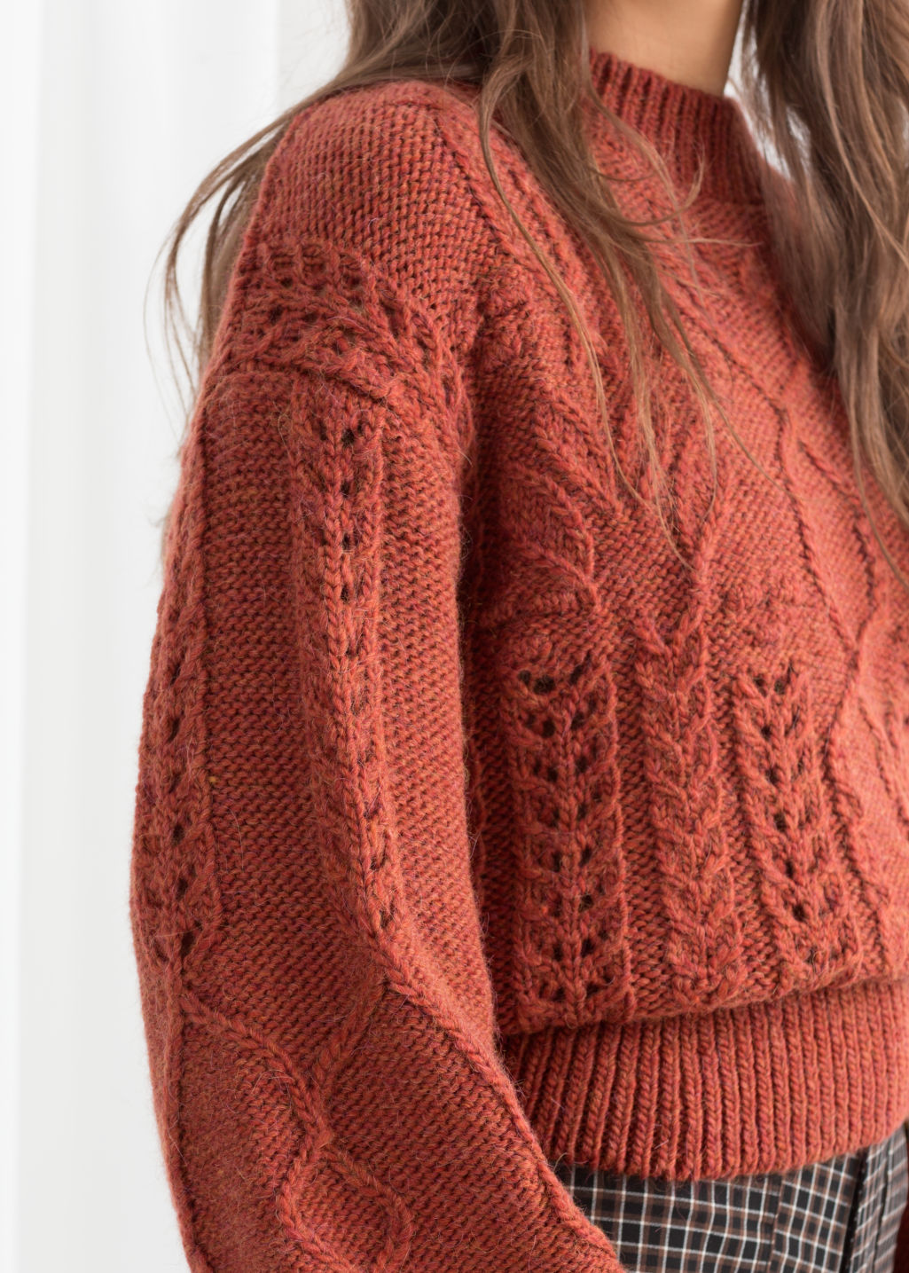 Model back image of Stories floral cable knit sweater in orange