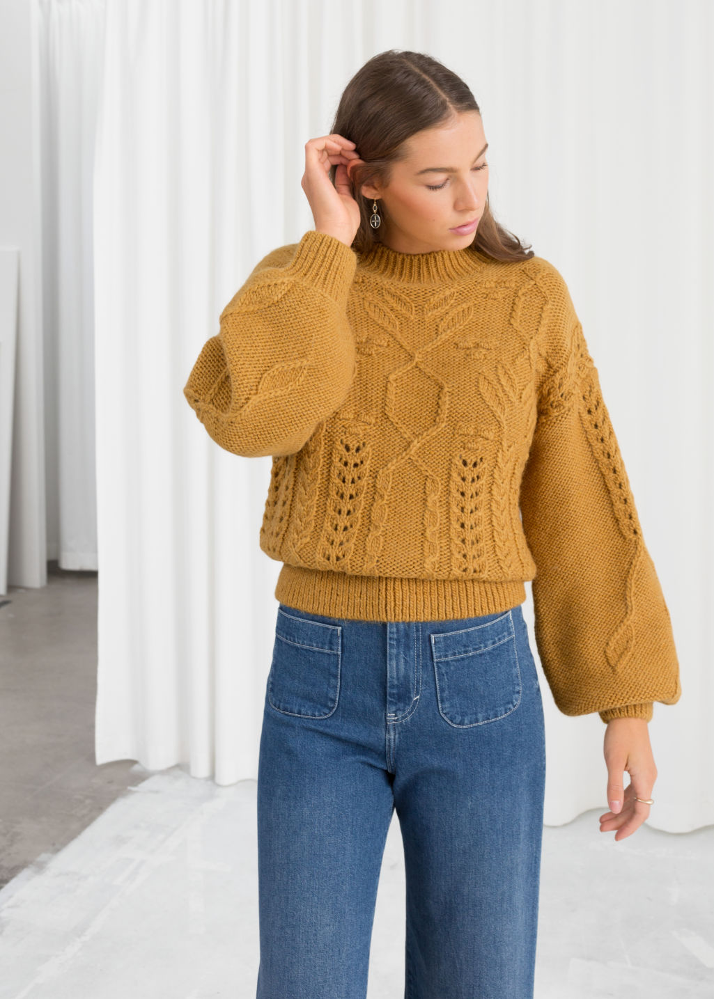 Model front image of Stories floral cable knit sweater in yellow