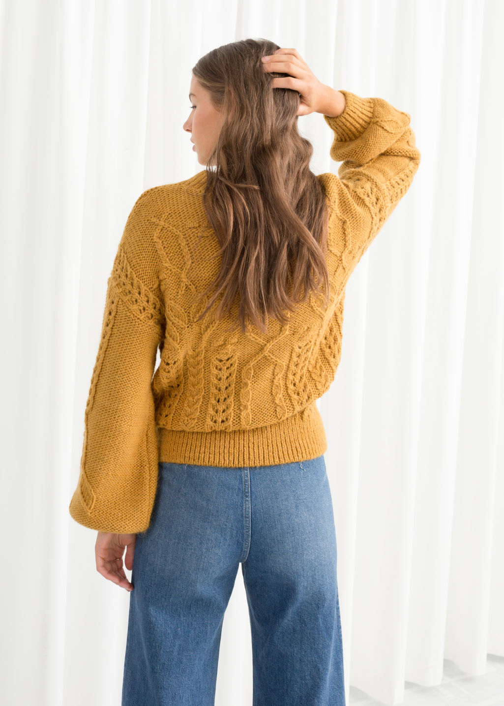 Model back image of Stories floral cable knit sweater in yellow