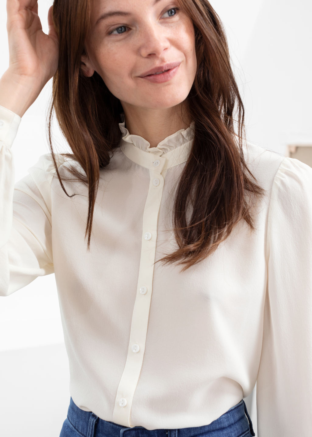 Model front image of Stories ruffle collar silk shirt in white