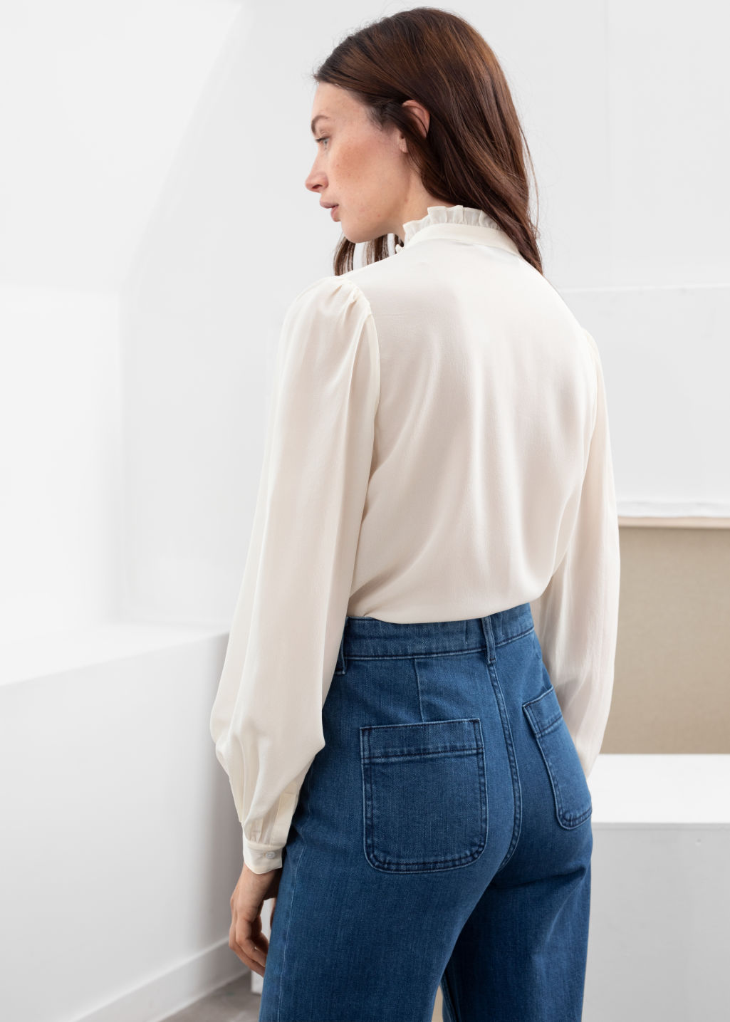 Model back image of Stories ruffle collar silk shirt in white