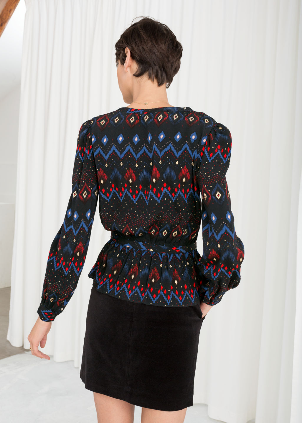 Model back image of Stories printed drop waist blouse in black