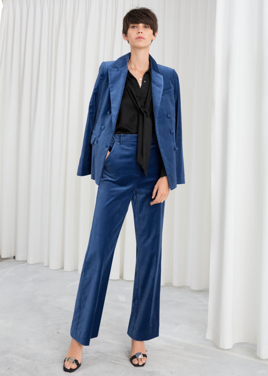 Model front image of Stories high waisted velvet trousers in blue