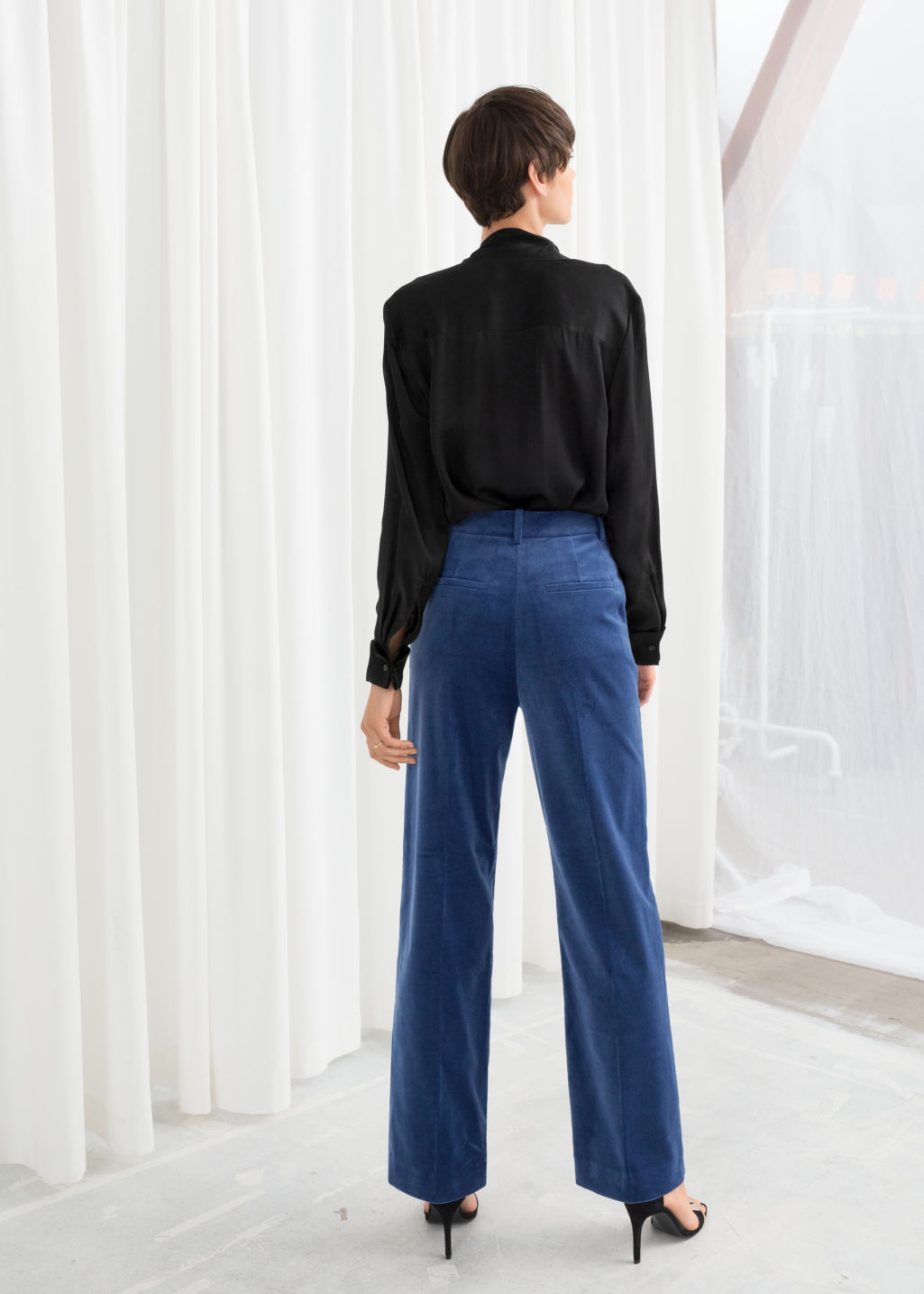 Model back image of Stories high waisted velvet trousers in blue