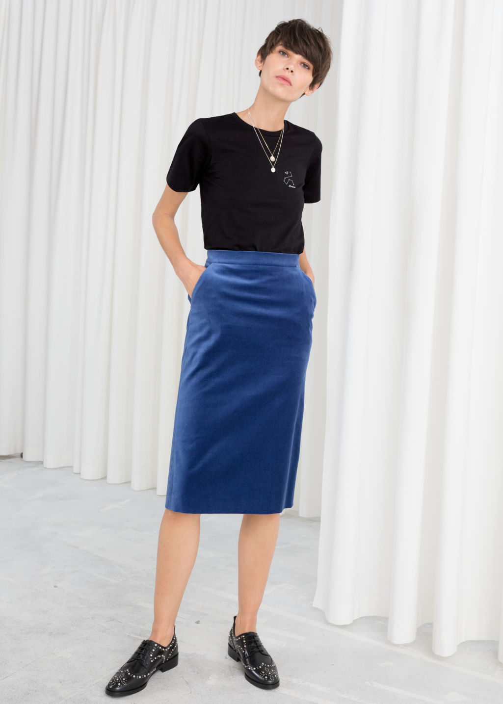 Model front image of Stories velvet midi pencil skirt in blue