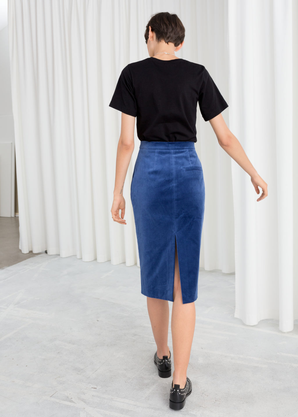 Model back image of Stories velvet midi pencil skirt in blue