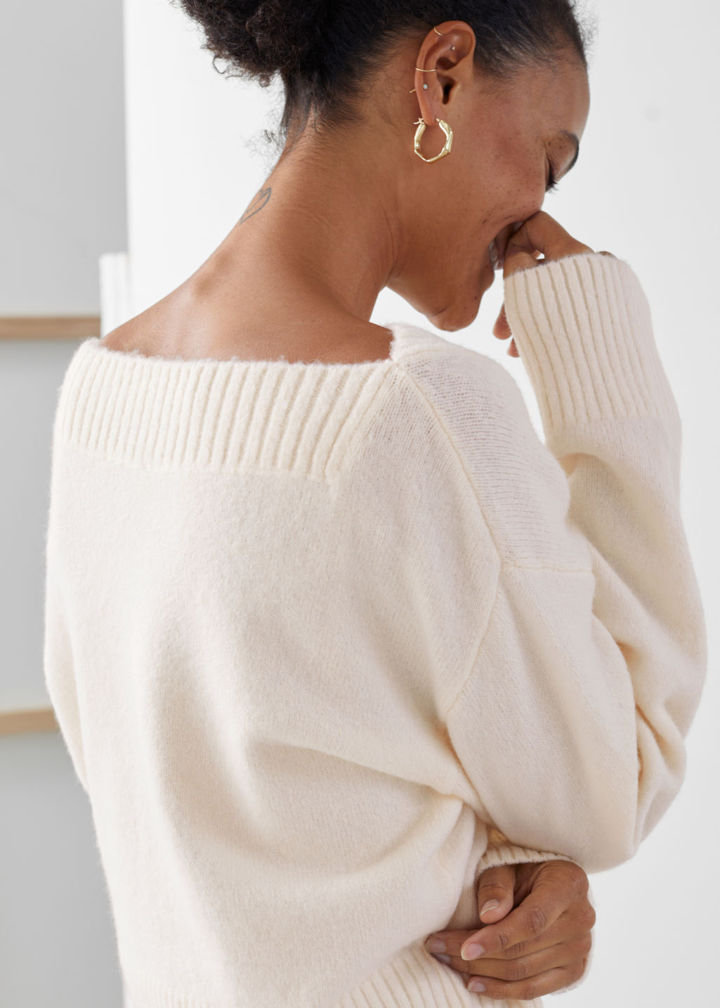 Model back image of Stories boatneck knit sweater in white