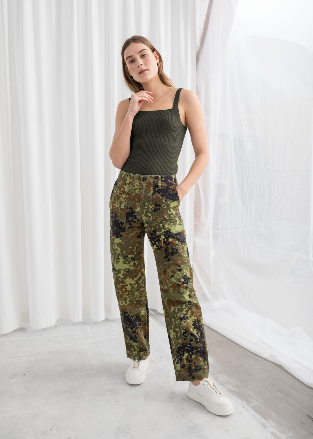 Model front image of Stories cropped twill workwear trousers in green
