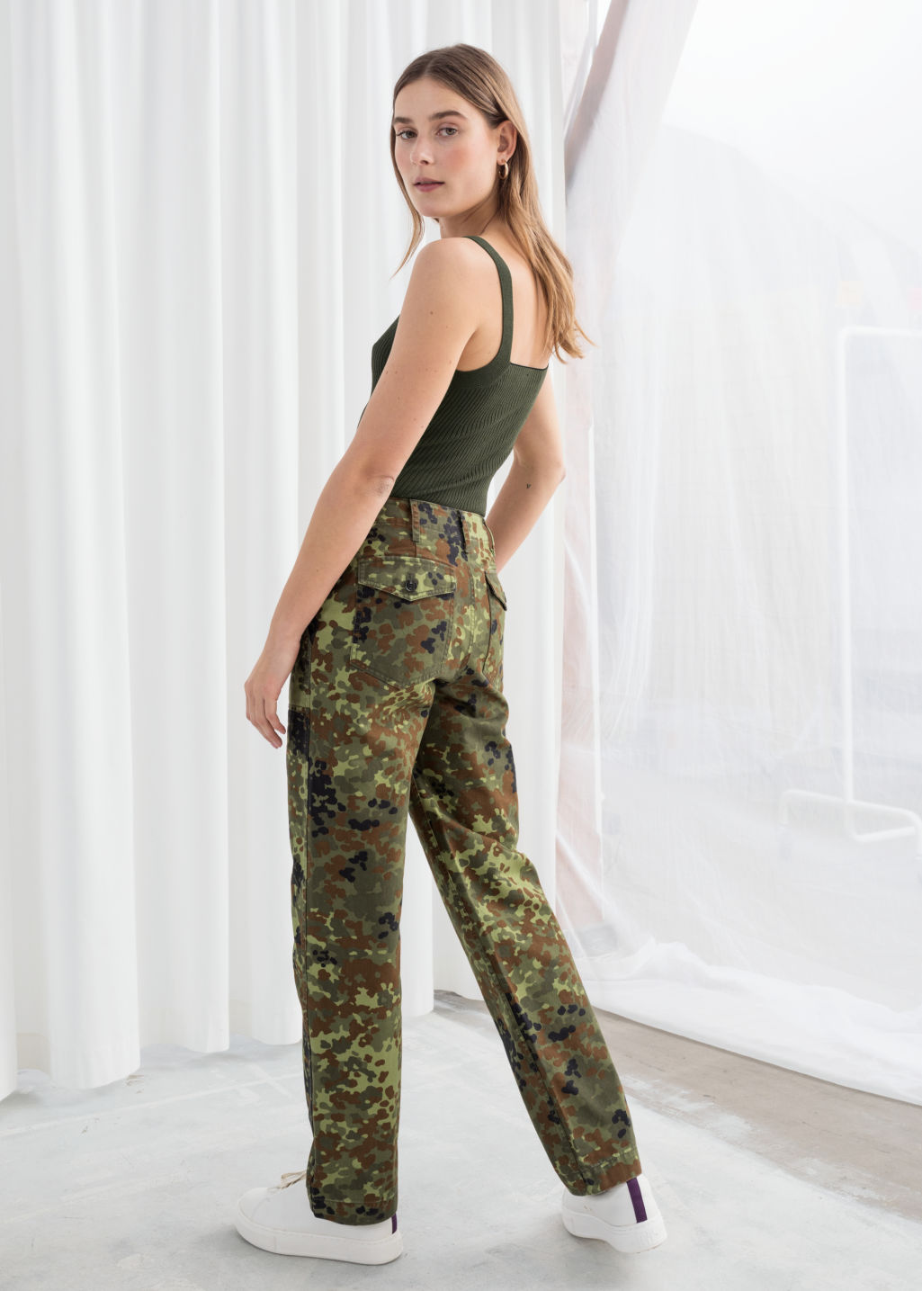 Model back image of Stories cropped twill workwear trousers in green