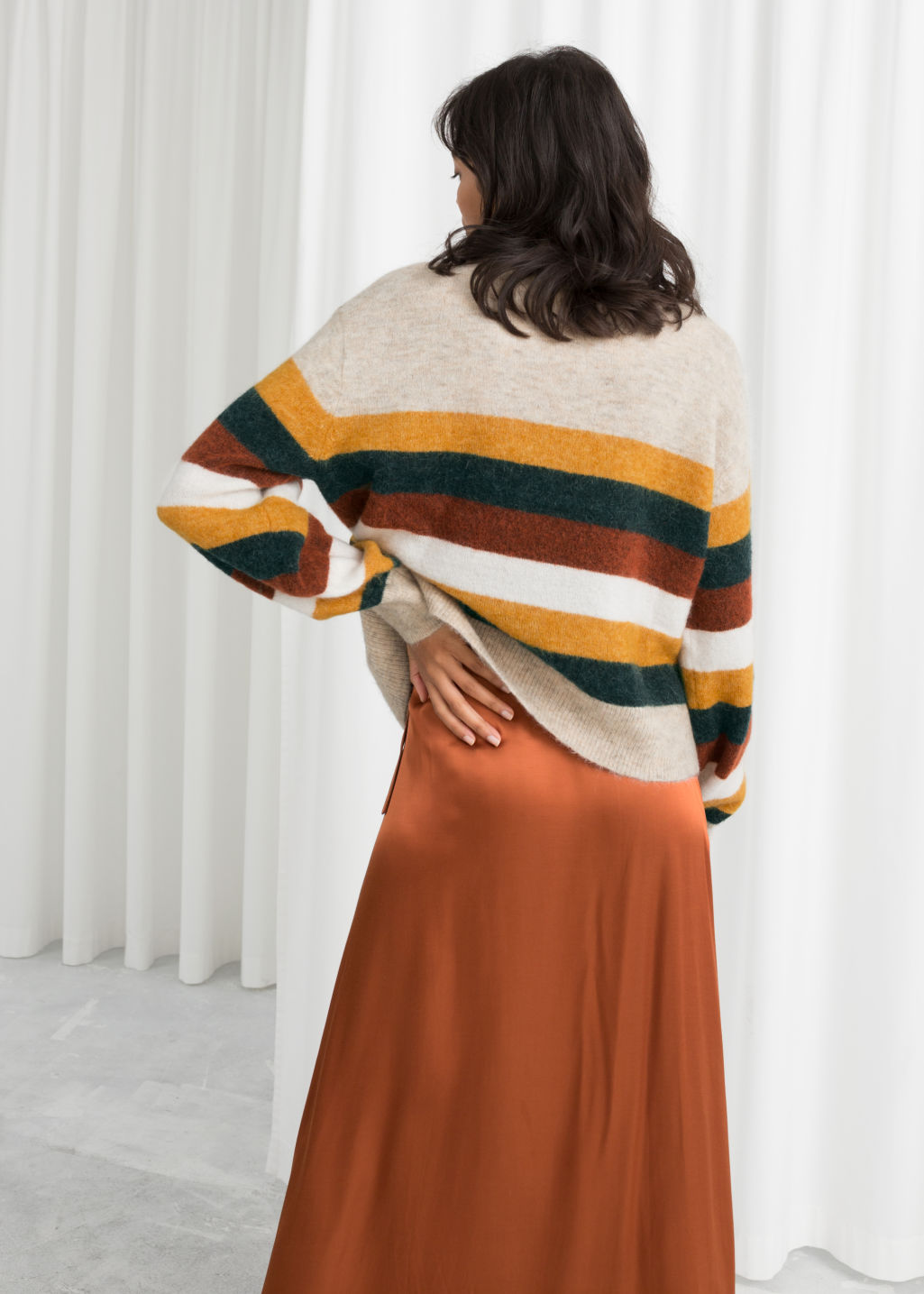 Model back image of Stories striped wool blend sweater in beige