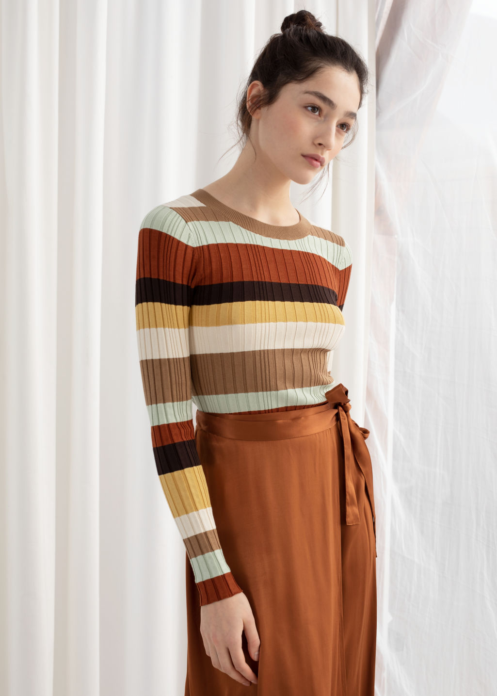 Model front image of Stories fitted striped rib top in orange