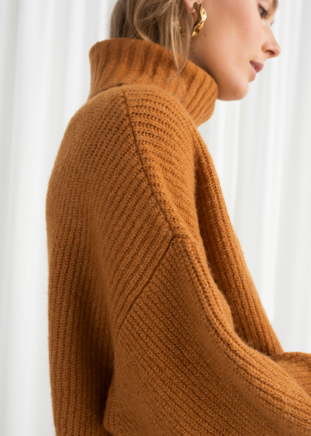 Model front image of Stories oversized turtleneck sweater in yellow