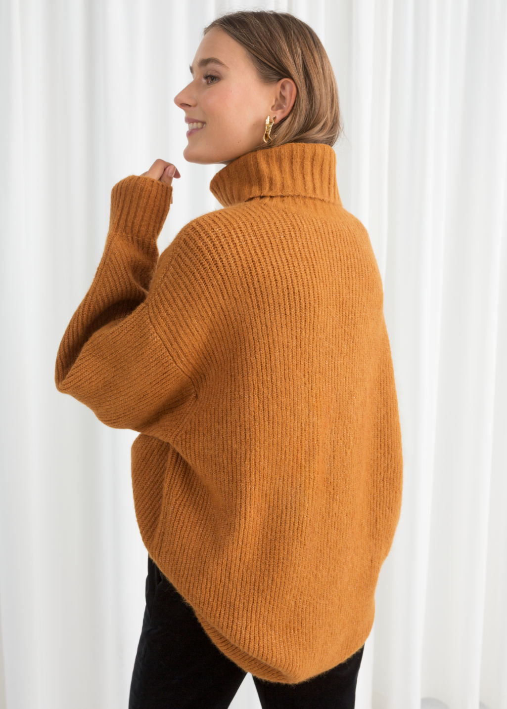 Model back image of Stories oversized turtleneck sweater in yellow