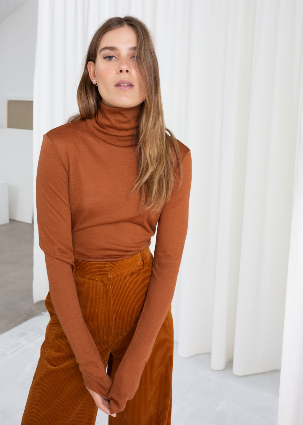 Model front image of Stories thin wool knit turtleneck in orange