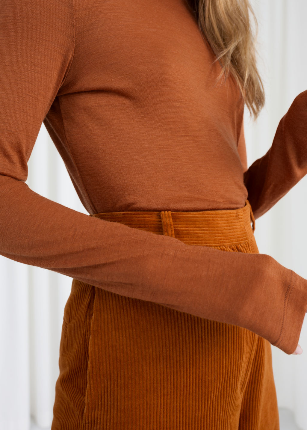 Model back image of Stories thin wool knit turtleneck in orange
