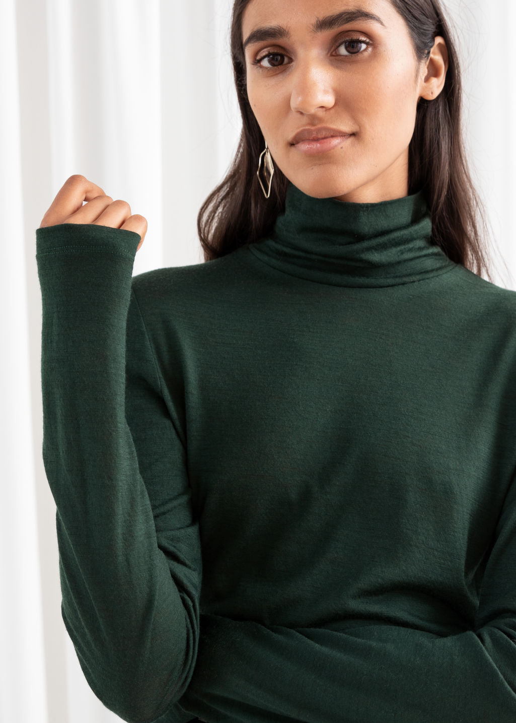 Model front image of Stories thin wool knit turtleneck in green