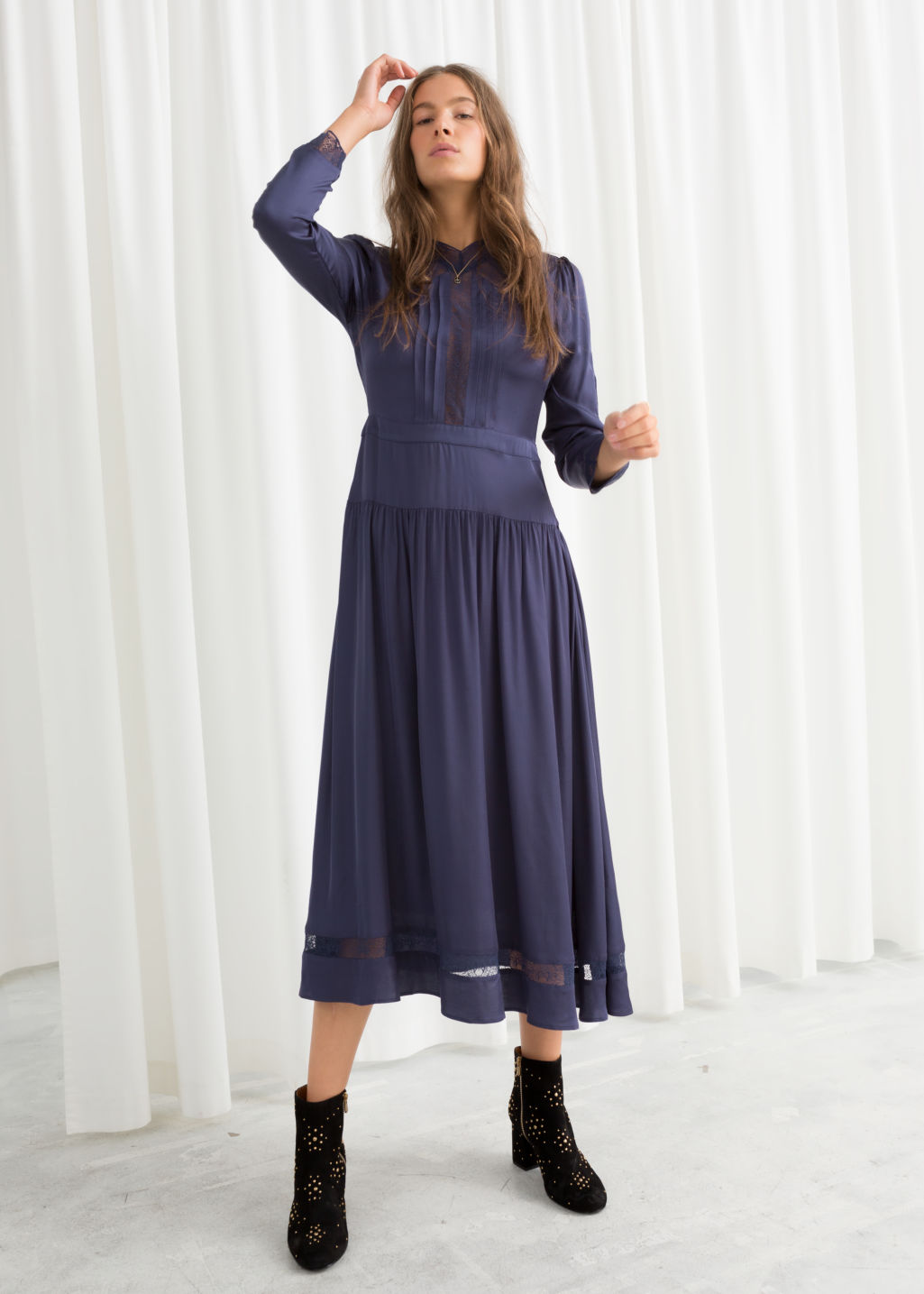 Model front image of Stories lace ribbon midi dress in blue