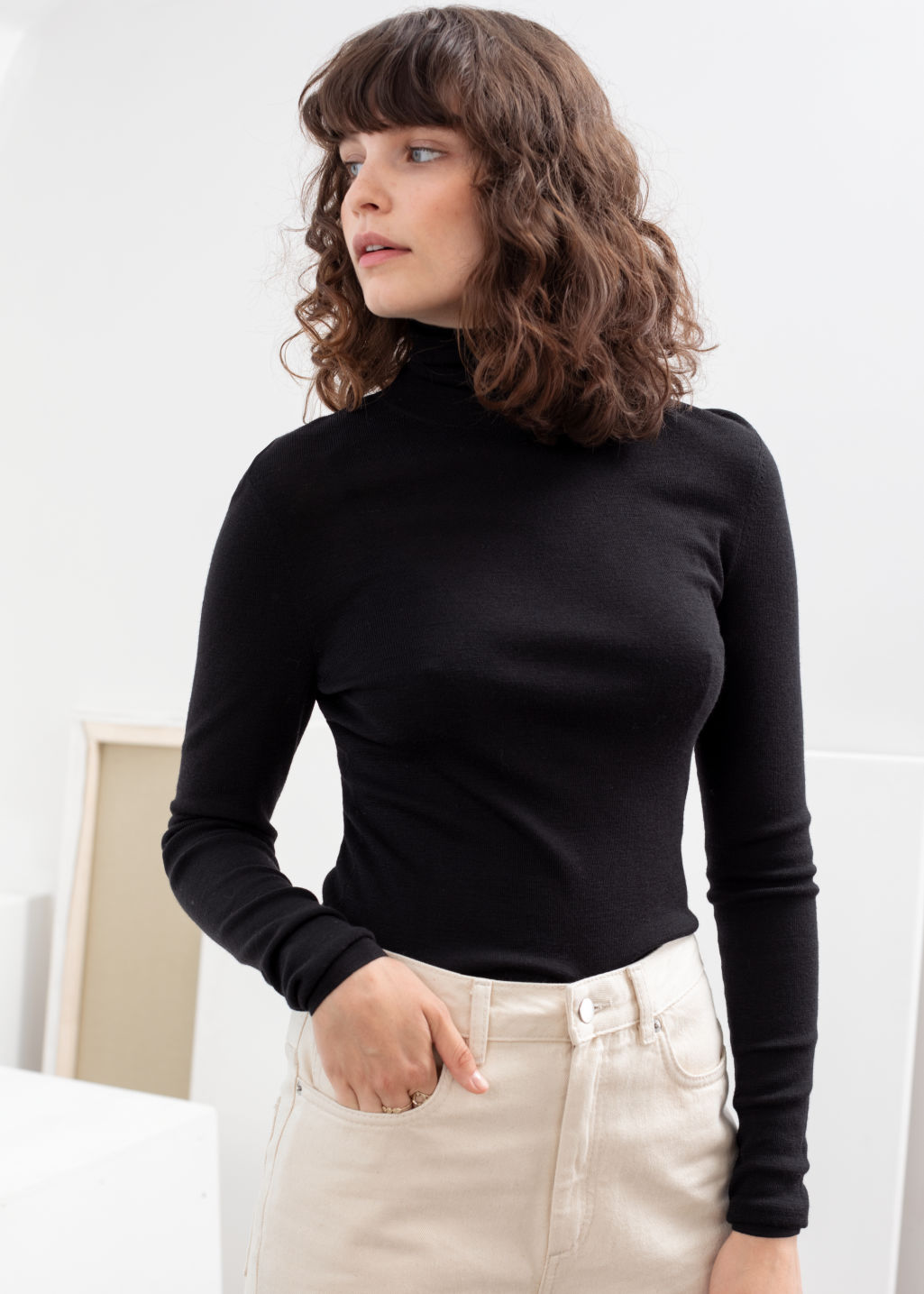 Model front image of Stories merino wool turtleneck in black