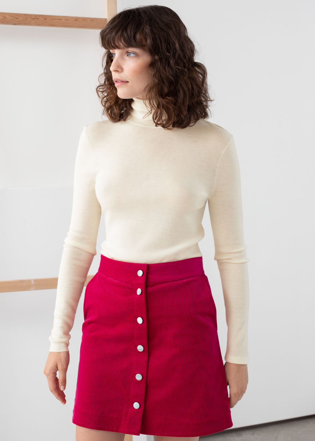 Model front image of Stories merino wool turtleneck in white