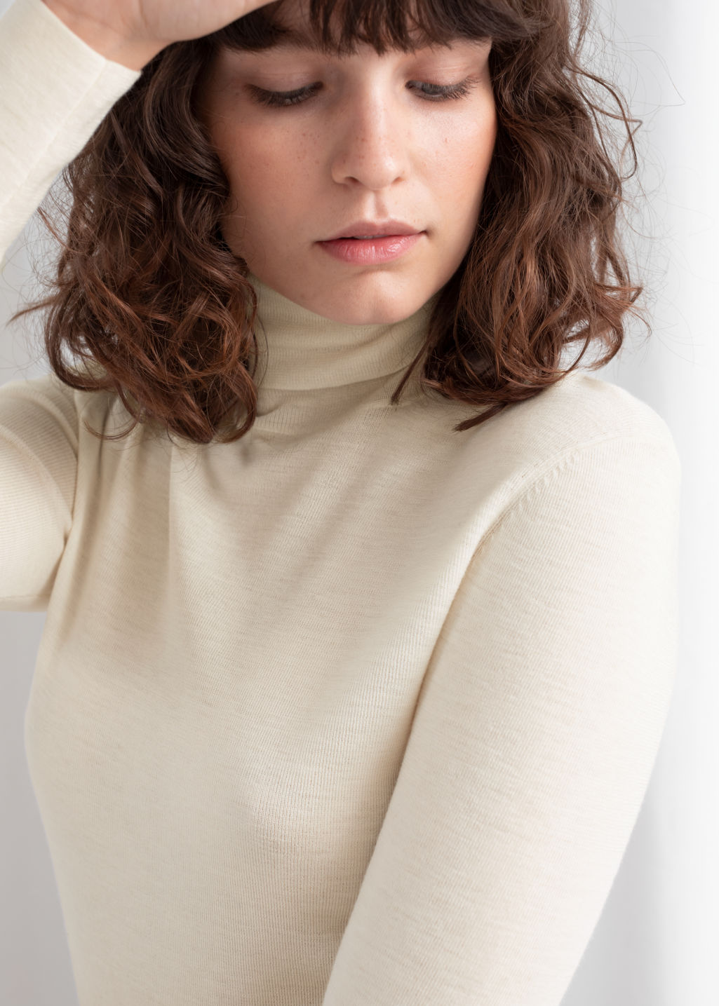 Model back image of Stories merino wool turtleneck in white