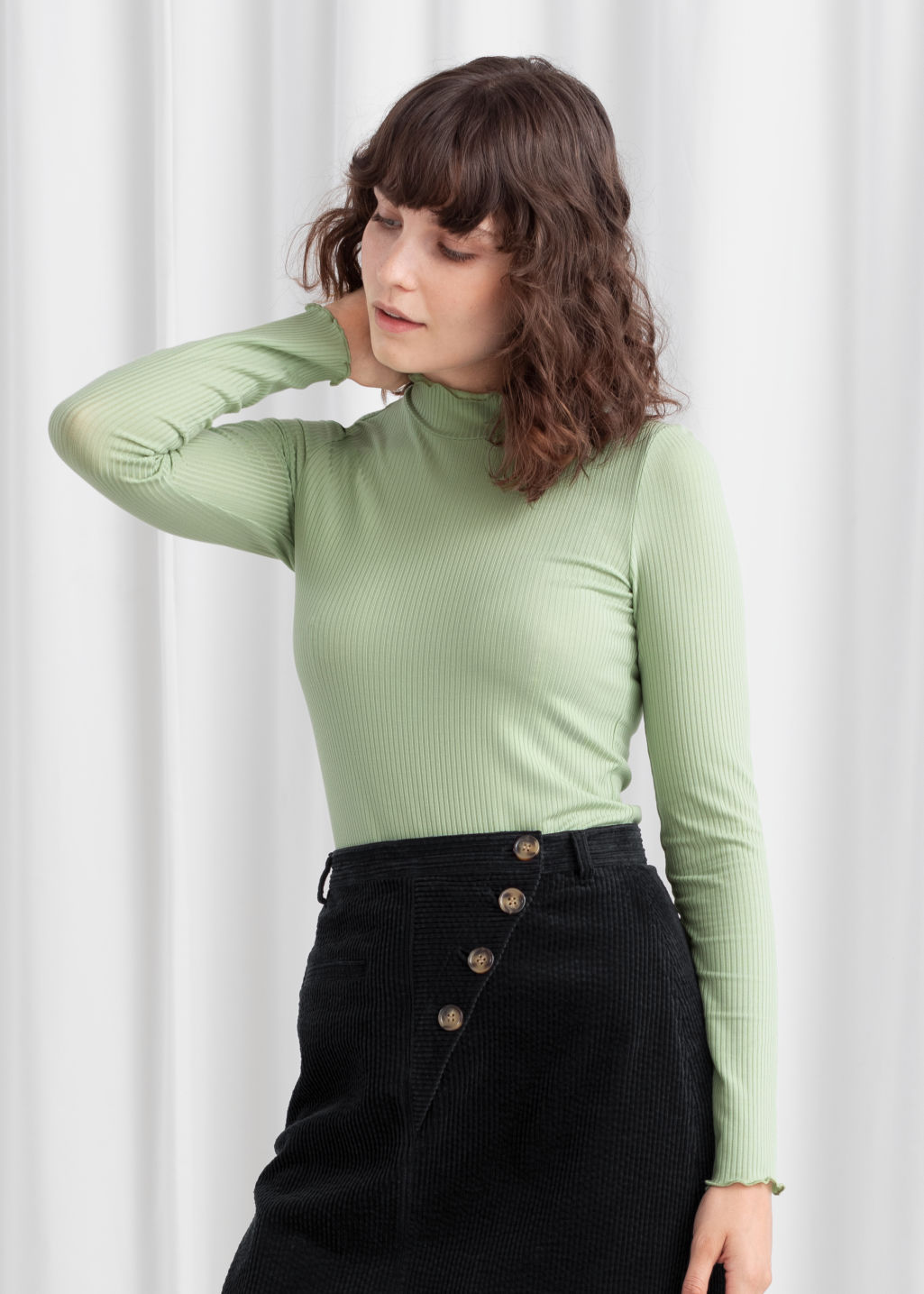 Model front image of Stories fitted stretch rib mock neck top in green